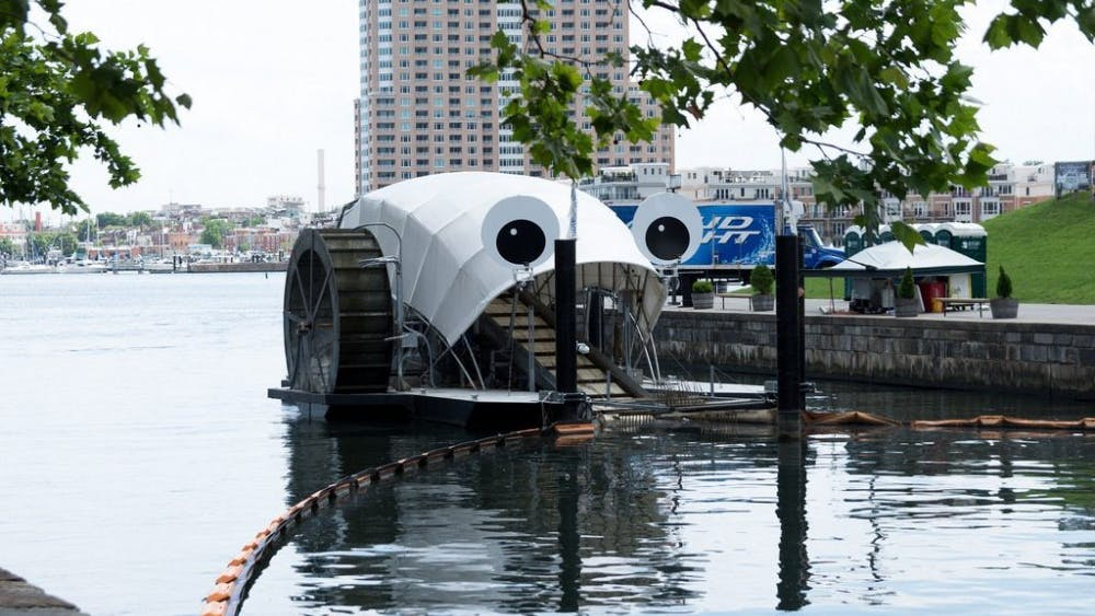 Matthew Bellemare/cc-by-sa 2.0 The iconic Mr. Trash Wheel rises up out of the Inner Harbor, just across from Pier Six.