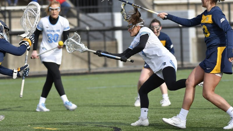 COURTESY OF HOPKINSSPORTS.COM Senior attacker Emily Kenul notches in her 100th career goal, being only the 24th Blue Jay to reach this accomplishment.