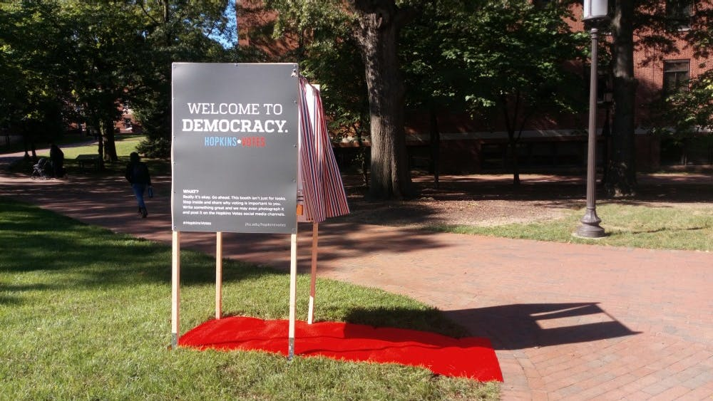 COURTESY OF MEAGAN PEOPLES The Center for Social Concern set up a booth to encourage students to vote.