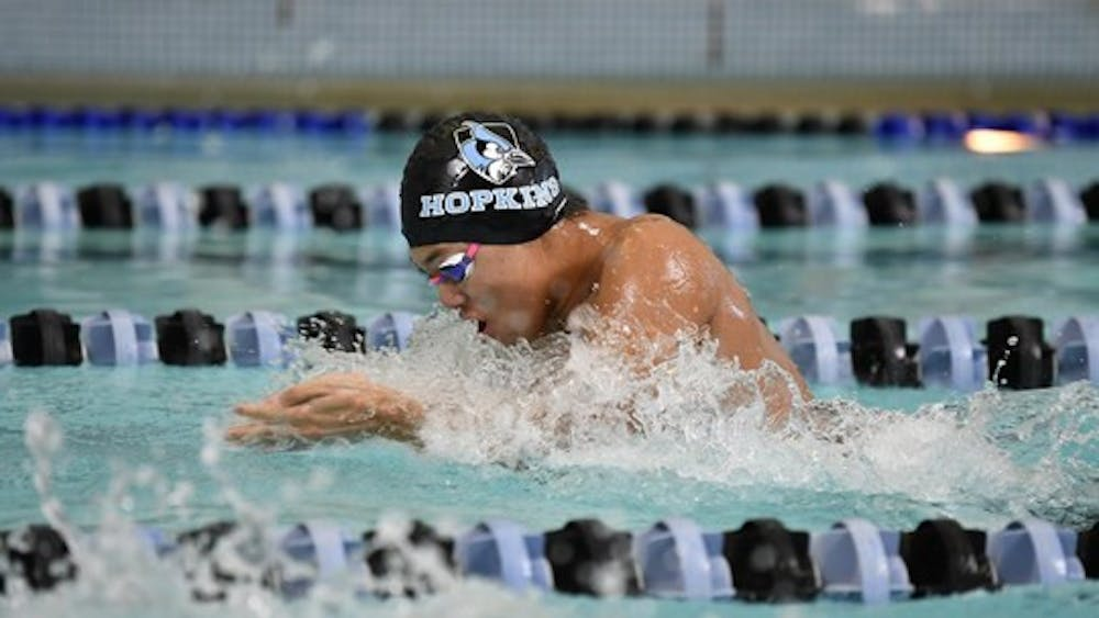 COURTESY OF HOPKINSSPORTS.COM After a long hiatus, the men's swimming team picked up where they left off.