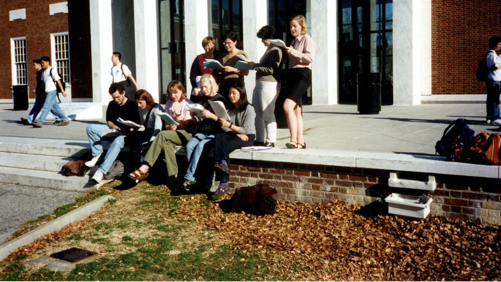 COURTESY OF THE UNIVERSITY ARCHIVES — SHERIDAN LIBRARIES Members of the Student Labor Action Committee read in front of MSE Library circa 2000, around the time Valdez joined The News-Letter.