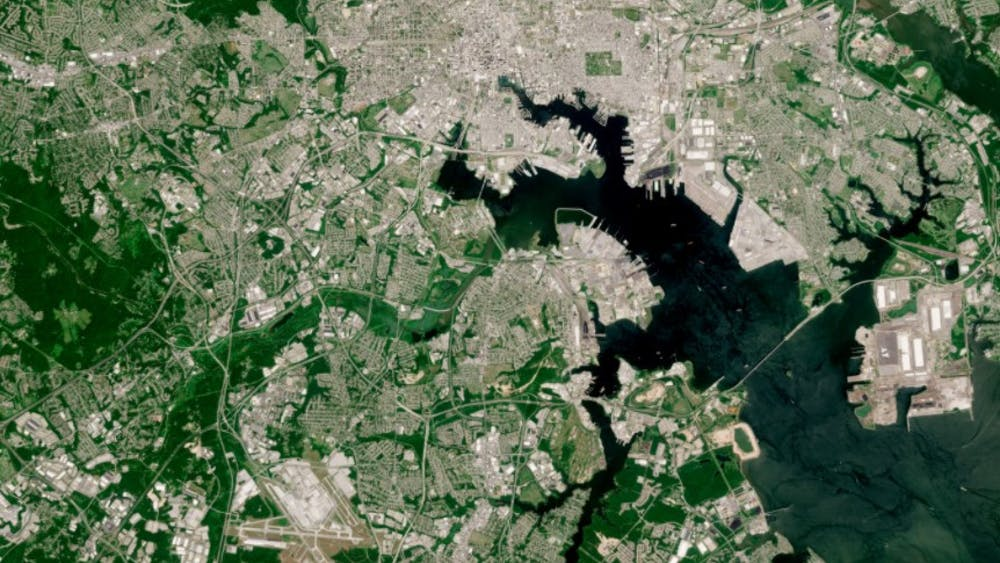 CC 3.0  CONTAINS MODIFIED CORPENICUS SENTINEL DATA 2020 This satellite image of Baltimore illustrates the lack of greenery in the city, making it susceptible to the urban heat island effect.