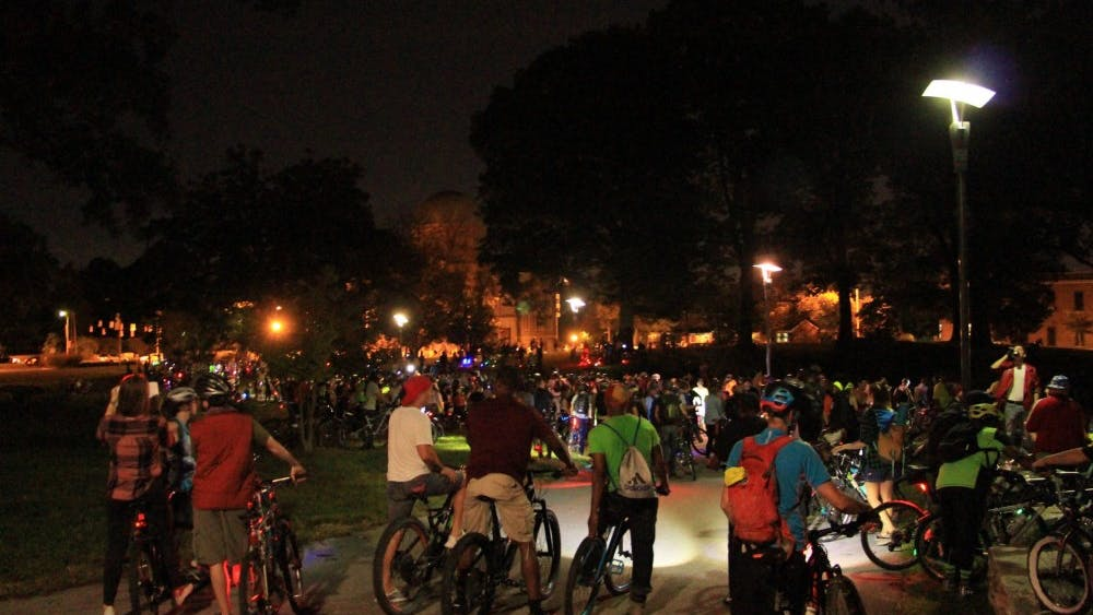 COURTESY OF AWOENAM MAUNA-WOANYA Bike Party participants gather in St. Mary's Park before the ride begins.