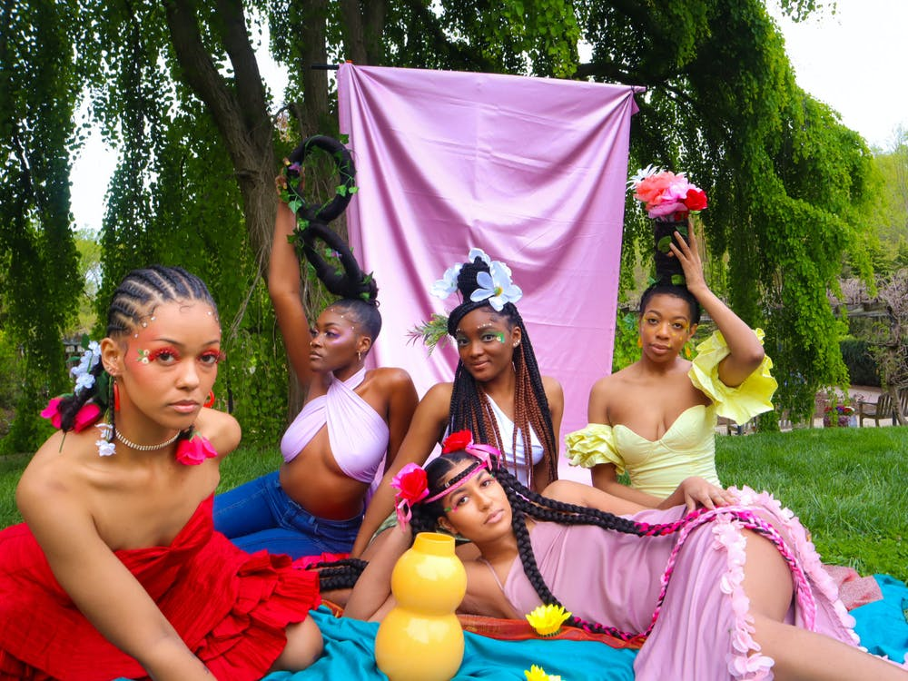 COURTESY OF MO.NA. GEMS. Models show off the colorful and sustainable designs of Mo.Na Gems.