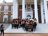 FILE PHOTO A 2018 rally by Refuel Our Future, urging Hopkins to fully divest from fossil fuels.