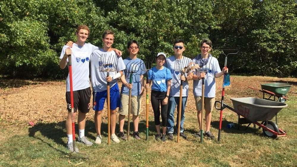 COURTESY OF SIGMA CHI Student groups, like fraternity Sigma Chi, volunteered in Baltimore.