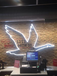 COURTESY OF CATHERINE PALMER The goose wings of the Wawa logo welcome customers.