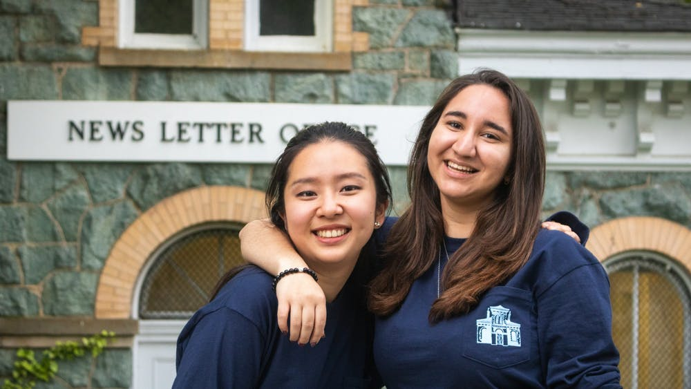 NEHA SANGANA/PHOTOGRAPHY STAFF Isaacs and Kim reflect on their accomplishments this year at The News-Letter.
