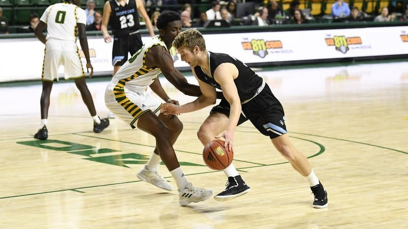 COURTESY OF HOPKINSSPORTS.COM  Junior Harry O'Neil makes lay up with only 0.6 seconds left in game to lift Jays to win 59-57.
