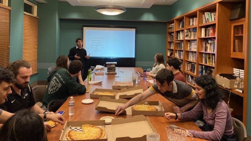 COURTESY OF MIRI CAZES Graduate student Giacomo Loi presented a talk on history and myths.