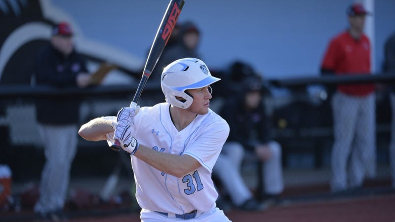 COURTESY OF HOPKINSSPORTS.COM  Sophomore shortstop Dillon Bowman hits a walk-off home run against the first-ranked Cortland State Red Dragons.