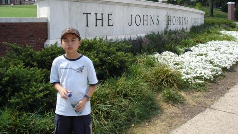 COURTESY OF ROLLIN HU Hu, age 9 in the photograph, never imagined that he would attend Hopkins.