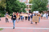COURTESY OF ALI GHASEMI Students protested outside Garland Hall, calling for an end to the JHU-ICE partnership.