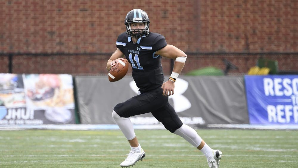 COURTESY OF HOPKINSSPORTS.COM  Junior quarterback David Tammaro leads Jays towards victory.