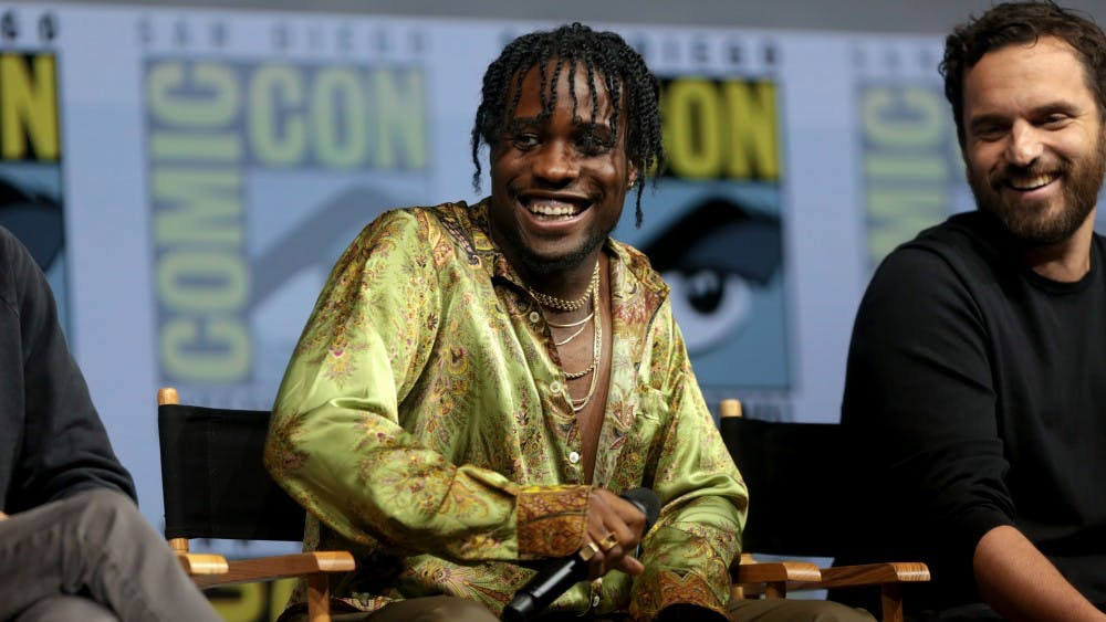 """Gage Skidmore/CC by-SA 2.0 Shameik Moore at SDCC 2018 discussing his role as Miles in the successful """"Into the Spider-Verse."""""""