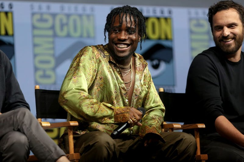 "Gage Skidmore/CC by-SA 2.0 Shameik Moore at SDCC 2018 discussing his role as Miles in the successful ""Into the Spider-Verse."""