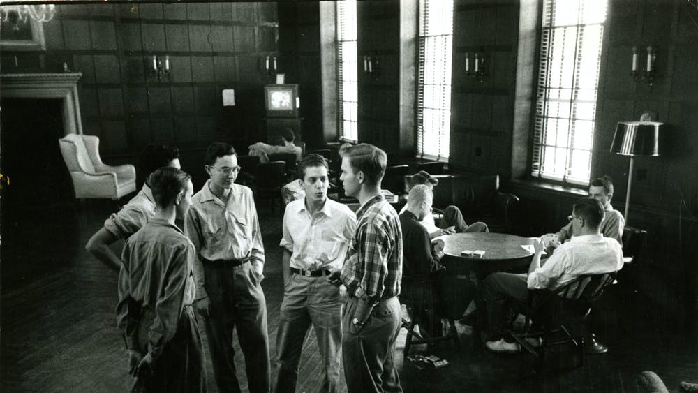 COURTESY OF THE UNIVERSITY ARCHIVES — SHERIDAN LIBRARIES Students discuss among themselves in AMR I circa the 1950s, around the time Baensch wrote for The News-Letter.