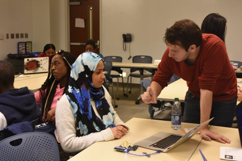 COURTESY OF KATHY HU Medhacks volunteers worked with Baltimore high schoolers at the event.