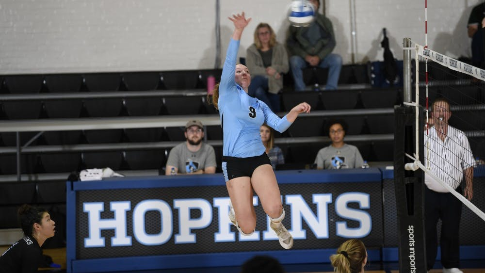 HOPKINSSPORTS.COM Senior hitter Michelle Abt earned 13 kills and 13 digs against the Fords.