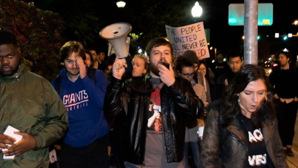 KAREEM OSMAN/PHOTOGRAPHY EDITOR Since Trump's victory, activism has exploded on campus. Corey Payne is pictured at center with megaphone.