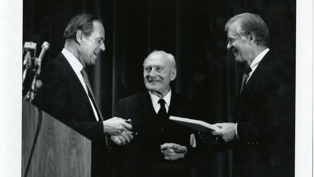 One of Gum's most memorable stories was covering the address to freshmen by then-University President Steven Muller, pictured in 1987 with former U.S. President Jimmy Carter and Alfred Carl Toepfer.