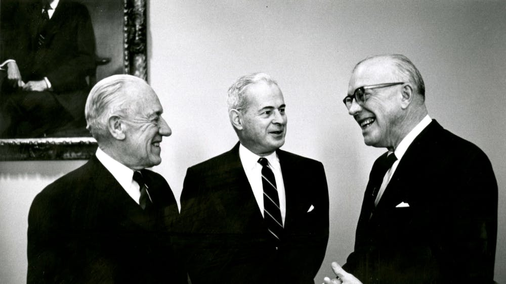 COURTESY OF THE UNIVERSITY ARCHIVES — SHERIDAN LIBRARIES  Reutter was Editor-in-Chief when University President Lincoln Gordon, pictured with University Presidents Milton S. Eisenhower and Detlev Bronk, was removed by a no-confidence vote in 1971.