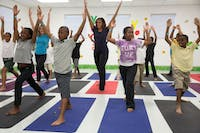 PUBLIC DOMAIN Students who practice yoga seem to have better performance at school.