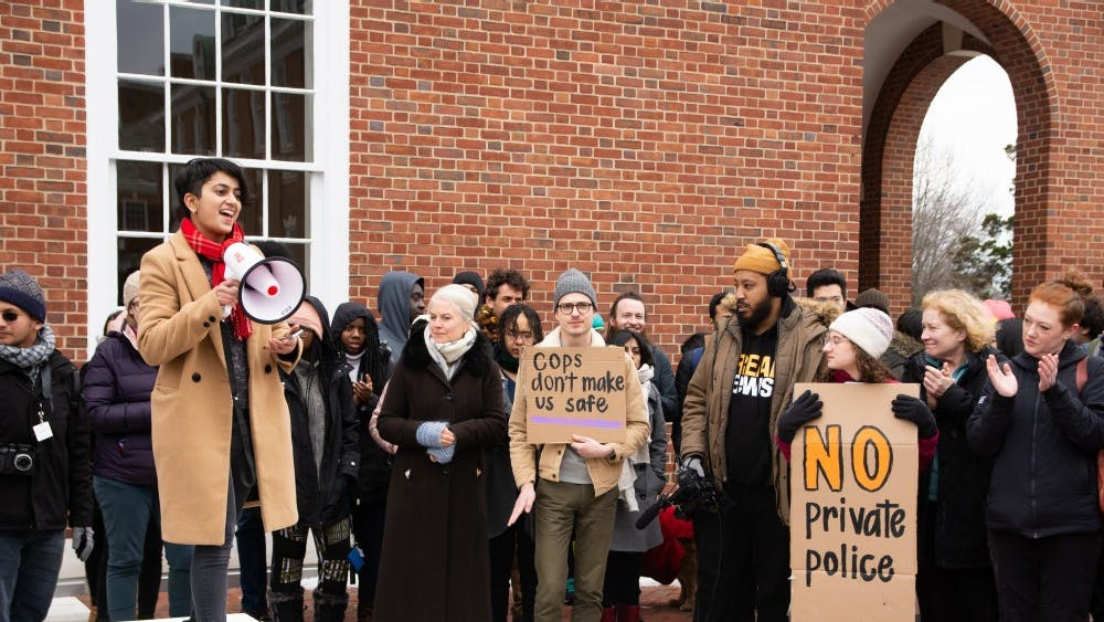 FILE PHOTO Students and faculty protested plans for a campus private police force in April 2019.