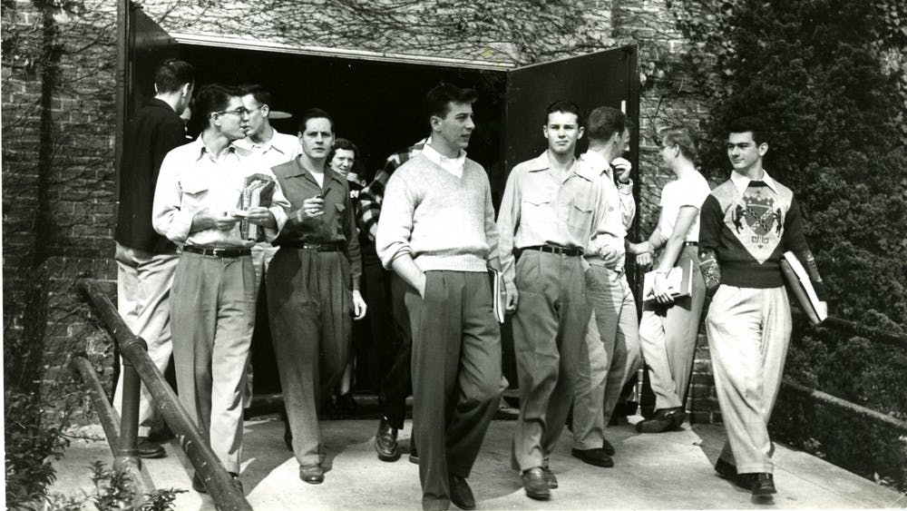 COURTESY OF THE JOHNS HOPKINS UNIVERSITY GRAPHIC AND PICTORIAL COLLECTION Students exit a building after class circa the 1950s, around when Cleveland first arrived at Hopkins.