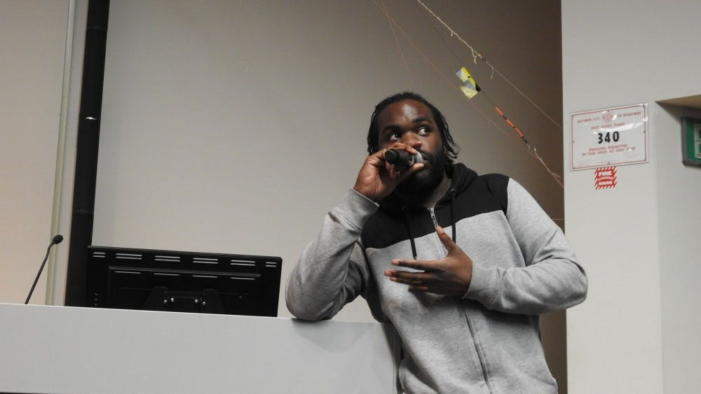 courtesy of Jon Schroeder/JHU  Consensus performed show 'ConCERNed' on the Hopkins campus, combining rap and STEM fields