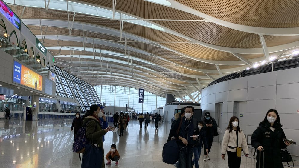 COURTESY OF YANNI GU Travelers at Shanghai Pudong International Airport wore masks to avoid contracting the coronavirus in January.