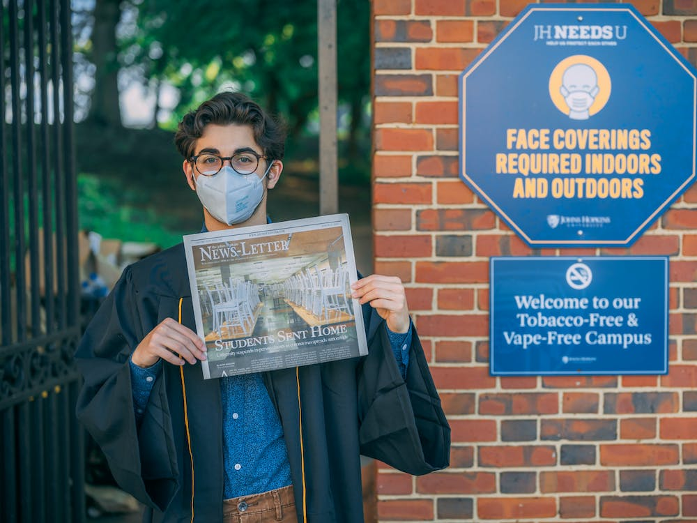 COURTESY OF DAVID HOFFMAN Malcom holds the last print issue of The News-Letter.