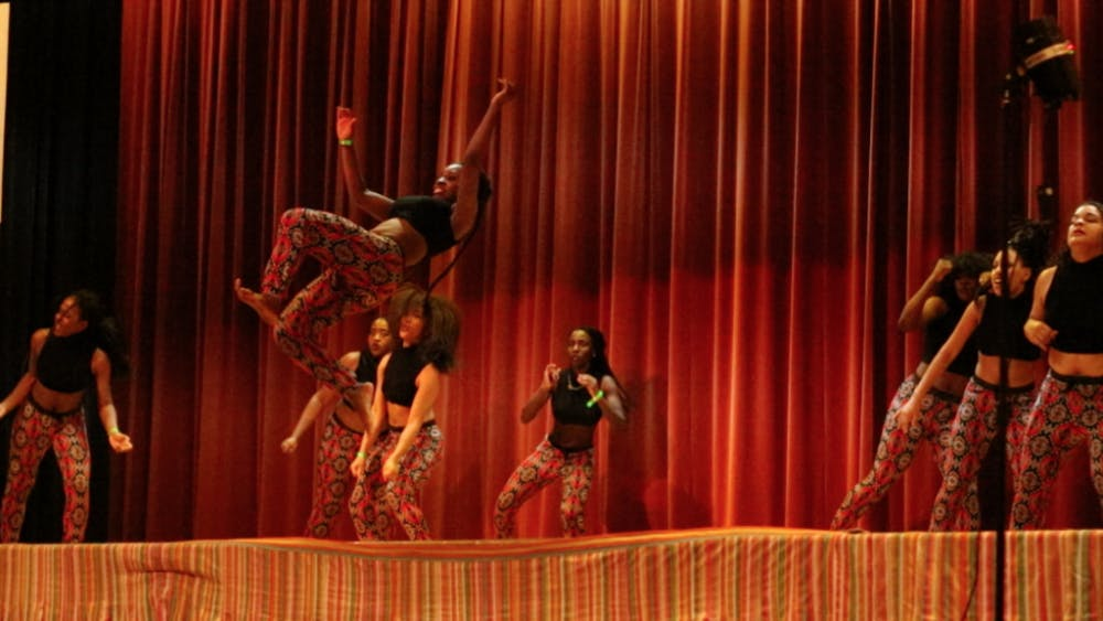 COURTESY OF BENJAMIN PIERCE The Temps d'Afrique dance team performs during the third annual Unity African Dance competition.