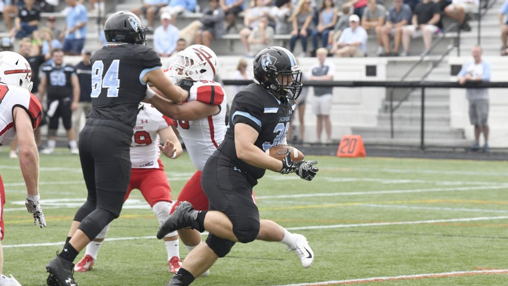 HOPKINSSPORTS.COM Junior running back Luke Yakely scored a touchdown in the Blue Jays' explosive second half.