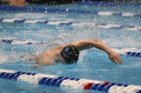 HOPKINSSPORTS.COM The men's swimming team beat Delaware but lost to host UMBC Saturday.