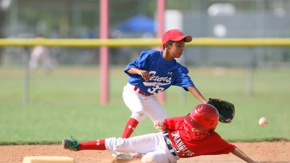 PUBLIC DOMAIN Playing team sports as a kid was shown to reduce depressive symptoms.