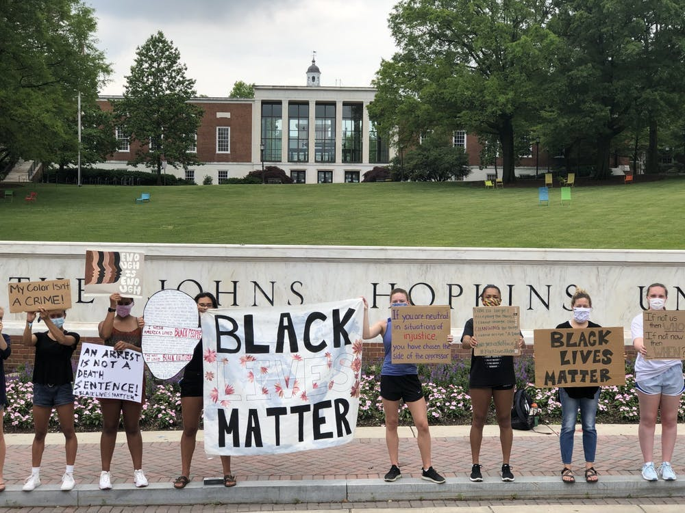 FILE PHOTO Protesters gathered in front of the Hopkins sign in June to demand racial equality.