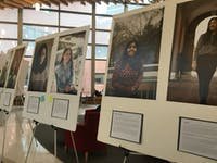 COURTESY OF KAREN WANG The gala featured photos of student immigrants and snippets of interviews in which they shared their stories.