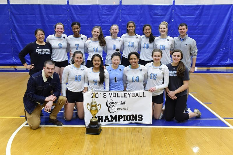 COURTESY OF HOPKINSSPORTS.COM  The volleyball team wins their third consecutive Conference Championship, as they swept their opponents in both the semifinals and finals.