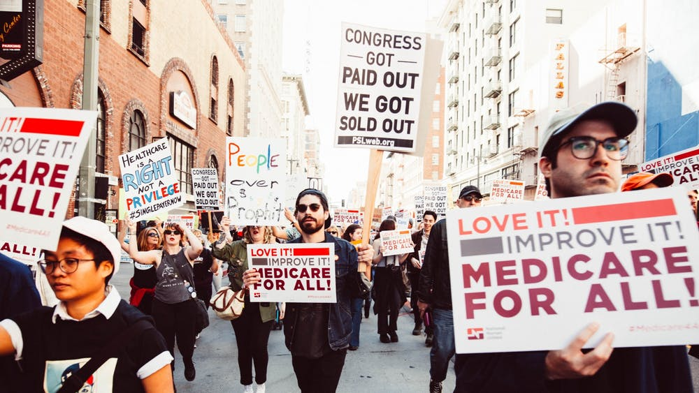 CC By 2.0 A rally in LA in support of Medicare for All, which Ravi argues in favor of.
