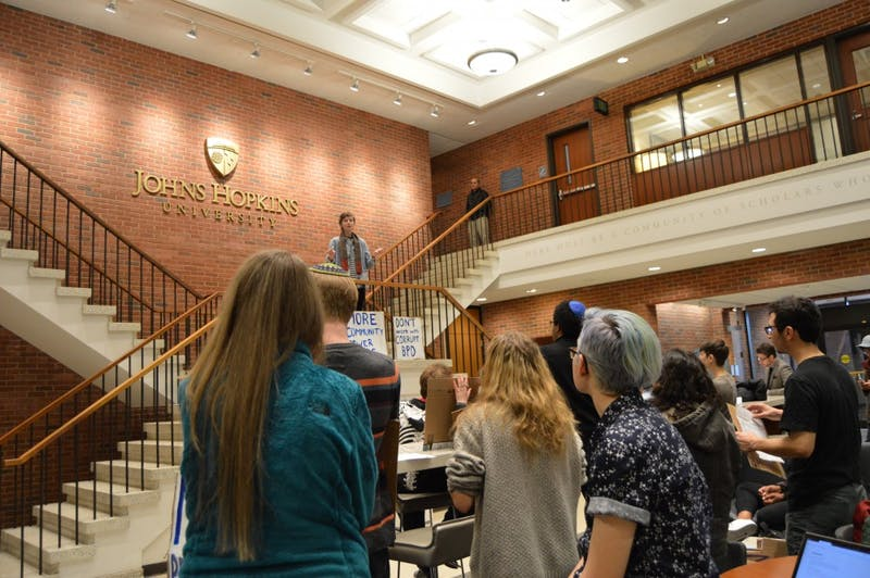 ELLIE HALLENBORG/PHOTOGRAPHY EDITOR Students gathered in Garland Hall and spoke against the proposed police force.
