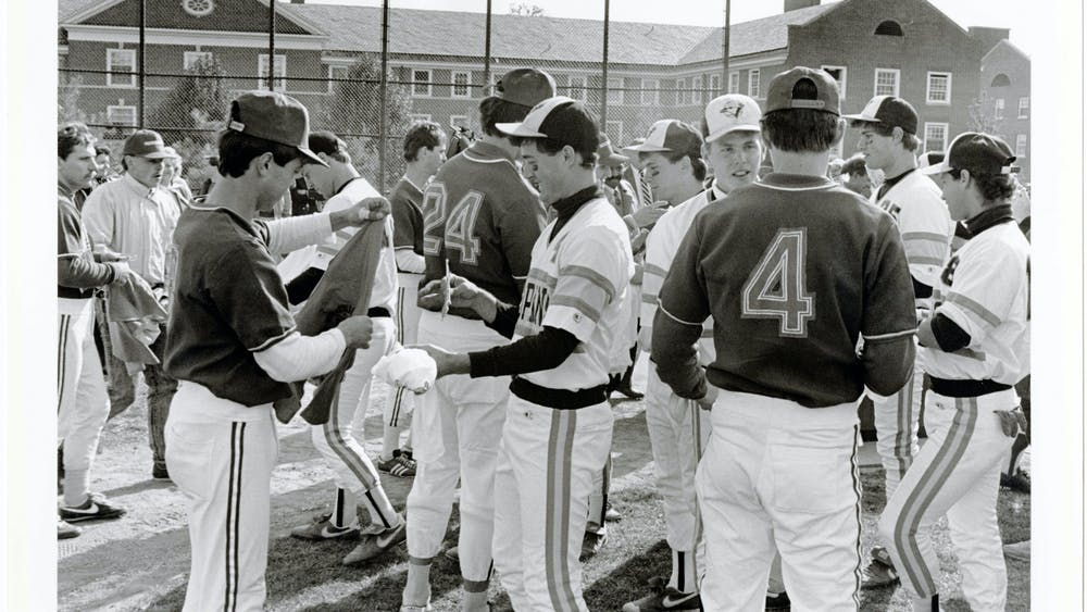 COURTESY OF THE JOHNS HOPKINS UNIVERSITY GRAPHIC AND PICTORIAL COLLECTION Members of the baseball team exchange gifts with a visiting Soviet team in 1988, which occurred during McGuckian's time with The News-Letter.
