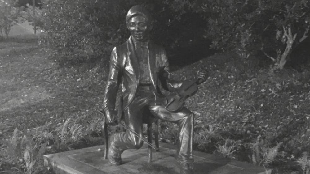 CINDY JIANG/PHOTOGRAPHY EDITOR A statue commemorating Rex T. Chao stands on N. Charles Street, depicting Chao with his violin.