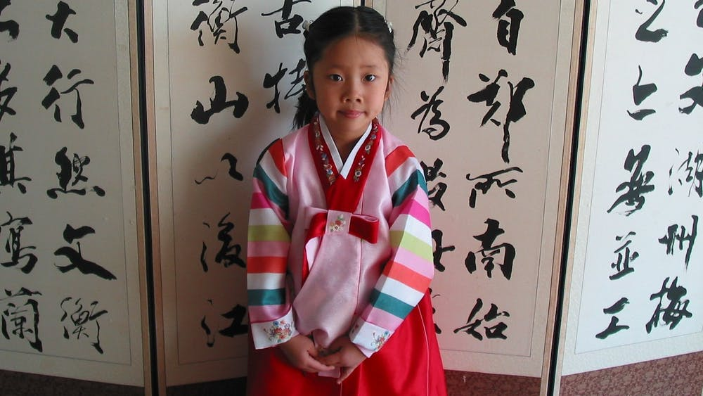 COURTESY OF SARAH Y. KIM As a child, Kim wore hanbok for special occasions.