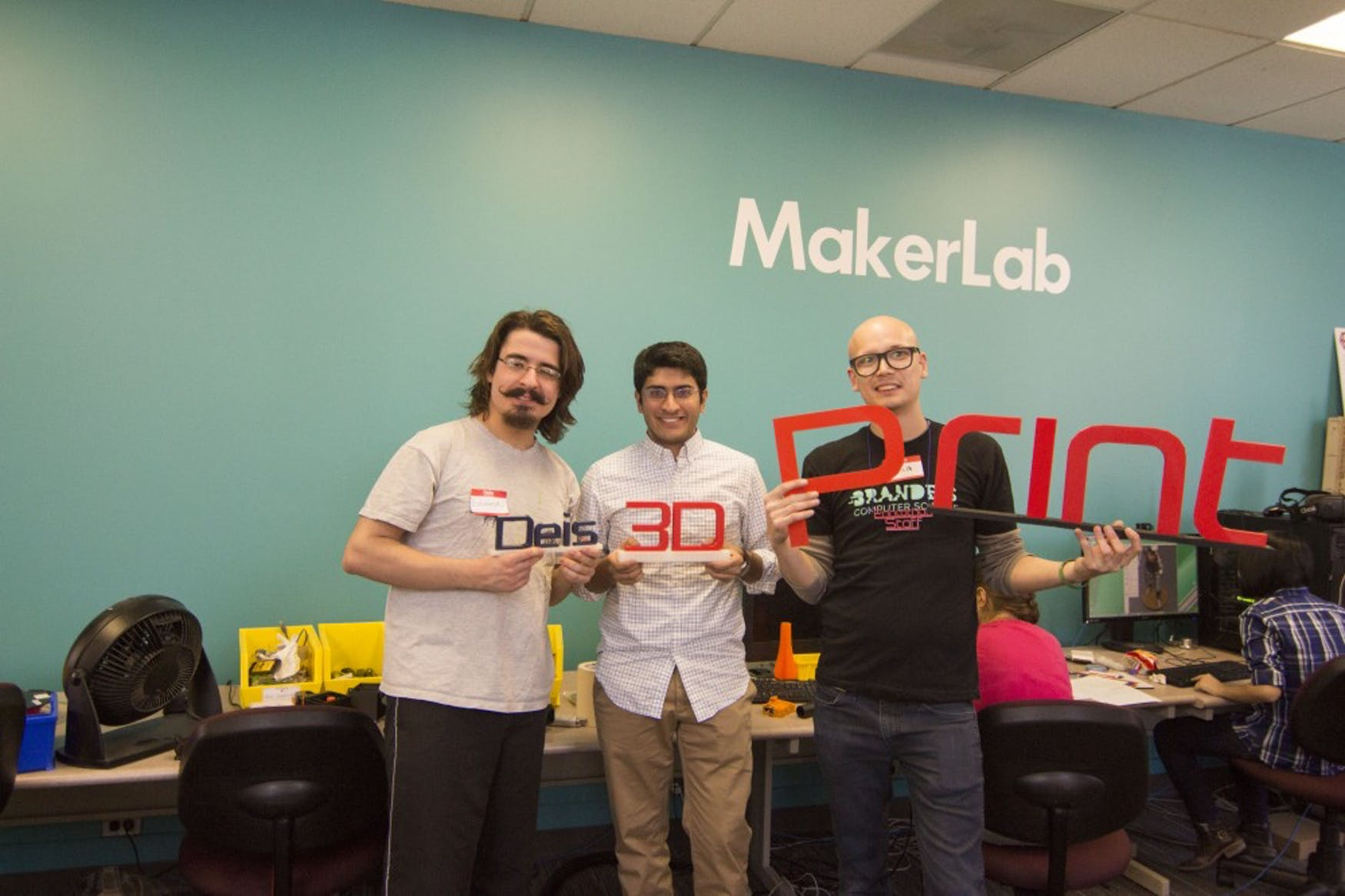 THE MASTER MAKERS: Deis3D members, (left to right) president Eduardo Beltrame '15, vice president Samir Undavia '17 and faculty adviser Ian Roy '05 (Research Technology Project Lead) hold some of the club's 3D creations in the MakerLab.
