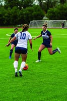 DOUBLE DEFENSE: Midfielders Zoe Balas '20 and Becca Buchman '19 swarm an attacker from Emory in their game on Oct. 14.