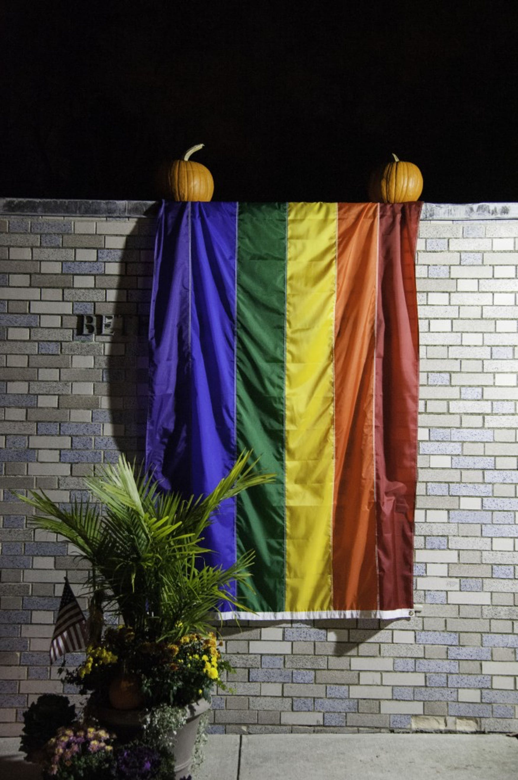 A flag hangs on the Catholic chapel for LGBTQ History Month.