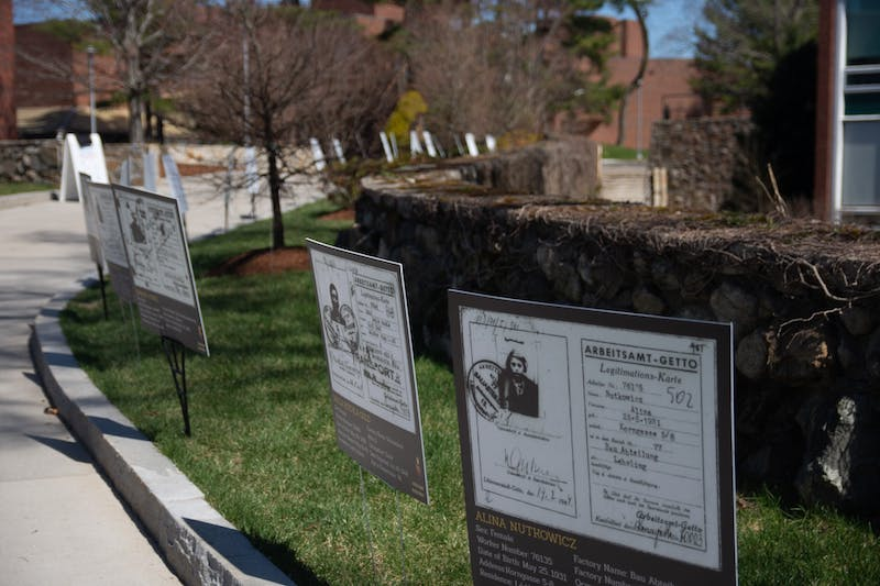 Brandeis Holocaust Remembrance and Education Events put up posters around campus of Jewish individuals' worker identification cards from the Lódz Ghetto.