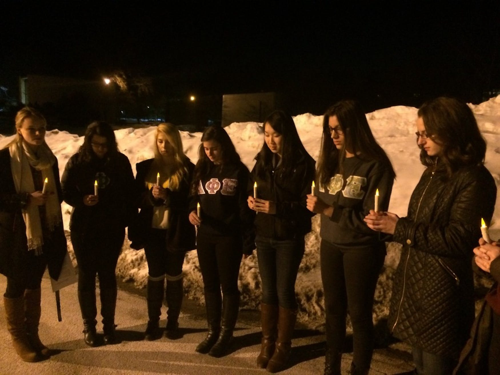 SEEKING SOLACE: Members of the Delta Phi Epsilon sorority hold a candlelight vigil to talk about eating disorders and share personal stories to spread awareness in their partnership with The National Association for Anorexia and Associated Disorders.