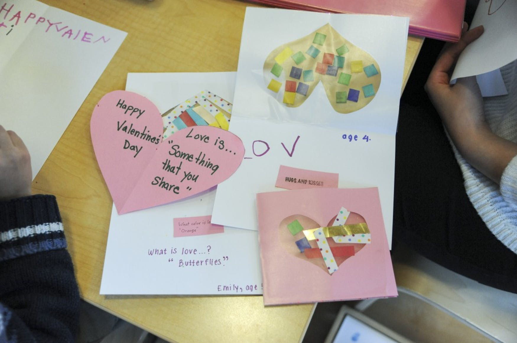 Some samples: Teachers work closely with the preschoolers to help them understand Valentine's Day and by asking them what they think love is.